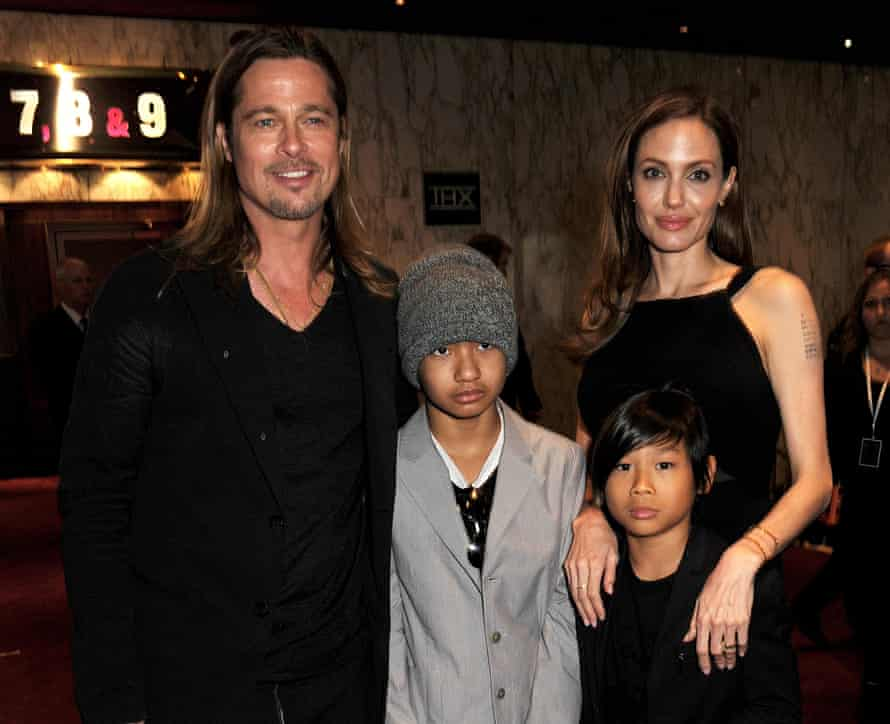 Pitt and Jolie with two of their adopted children, Maddox and Pax.