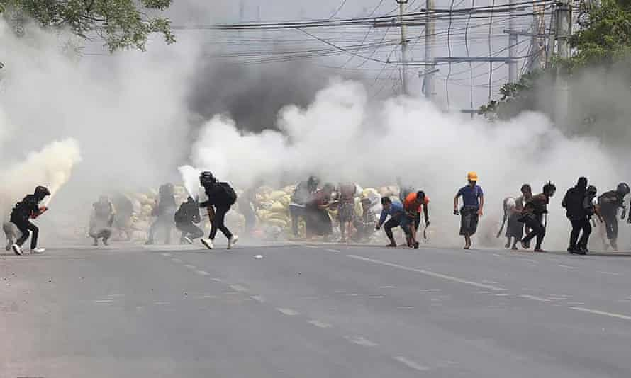 Protesters in Mandalay as teargas is fired by security forces and some demonstrators also let off fire extinguishers.