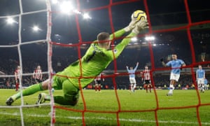 Sheffield United's Dean Henderson dives to his right to save a first-half penalty.
