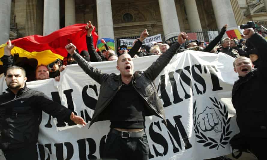 Far-right protestors near a memorial to the victims of the Brussels terrorist attacks.
