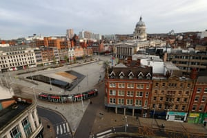 A tram passes through Nottingham Market Square at the start of the four week national lockdown for England