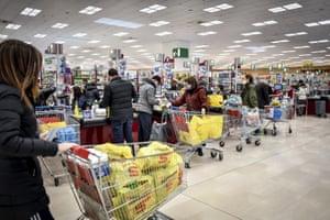 People crowd a supermarket in Milan