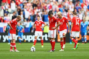 Jonathan Williams, Gareth Bale and Aaron Ramsey look down after the equaliser.