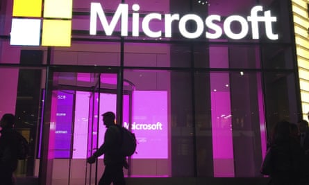 FILE - In this Nov. 10, 2016, file photo, people walk near a Microsoft office in New York. Consumer advocates and the data-hungry technology industry are drawing early battle lines in 2019 in advance of an expected fight over a national privacy law. A think tank backed by Google, Amazon, Microsoft and other major tech companies proposed changes that would still give the industry broad authority to collect and use customer data. (AP Photo/Swayne B. Hall, File)