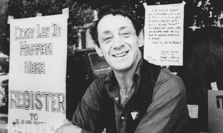 Harvey Milk poses in front of his camera shop in San Francisco in 1977.