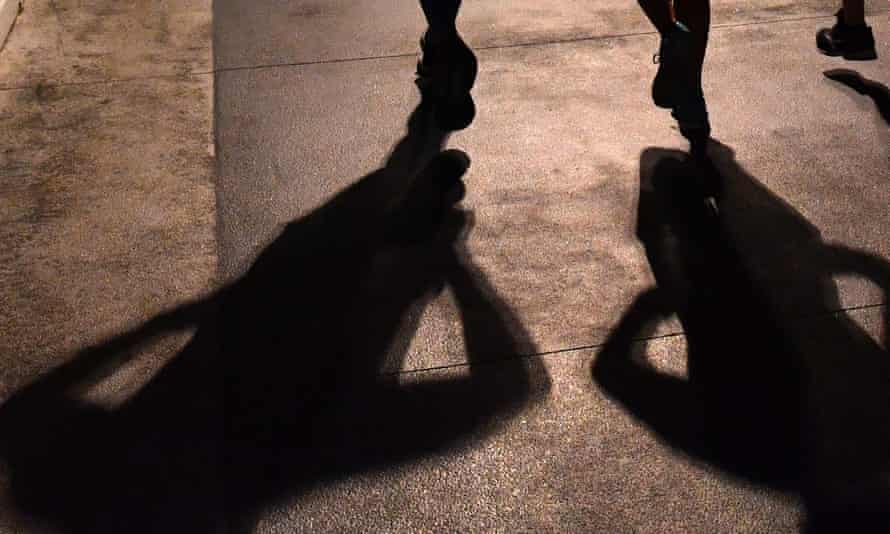 Shadows of group of people jogging