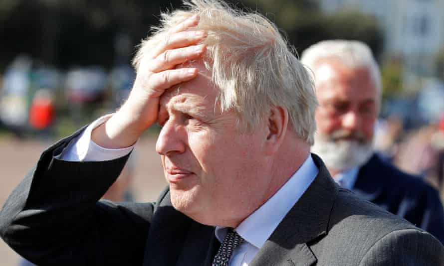 Britain's Prime Minister Boris Johnson gestures as he campaigns in Llandudno, north Wales on April 26, 2021, ahead of the May 6 Welsh elections.