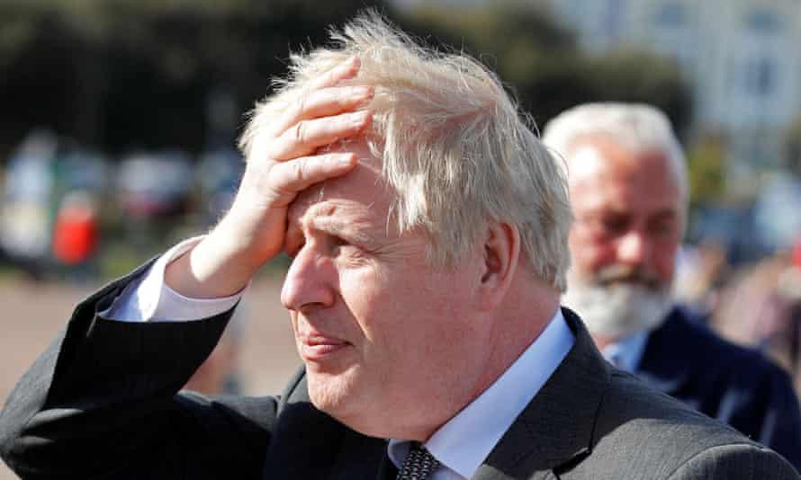 Boris Johnson gestures as he campaigns in Llandudno, north Wales.