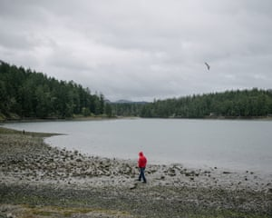 Lummi Tribal Chairman Jeremiah Julius walks the beach on English Camp on the Puget Sound following a ceremonial feeding of the qwe 'lhol mechen, commonly known as orcas, Wednesday, April 10, 2019 in Washington.