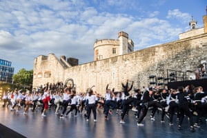 Dancers and musicians fill the Tower of London moat for East Wall, a new outdoor performance celebrating east London.