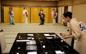 Koiku, Maki, Ikuko and Mayu, who are geisha, perform a dance routine for Reuters, before they work at a party being hosted by customers at Asada, a luxury Japanese restaurant in Tokyo, Japan, June 23, 2020