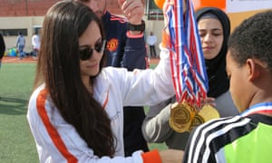Sarah El Jizi, head coach in the Beirut area for Right to Play, hands out football medals at Nahr el-Bared refugee camp in northern Lebanon