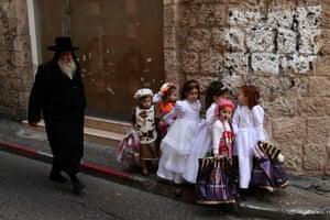 Israeli children dress in costumes to celebrate Purim in the Mea Shearim neighbourhood in Jerusalem