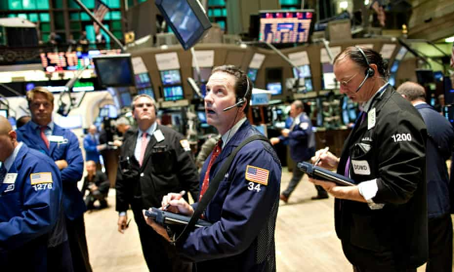 New York Stock Exchange traders watching markets dive.