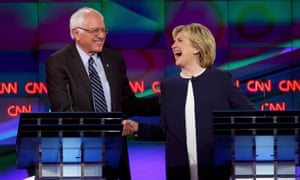 Clinton shakes hands with rival candidate Bernie Sanders