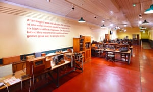 Wide shot of a room filled with telegraph equipment and desks and chairs at the Telegraph Museum, Cornwall, UK.