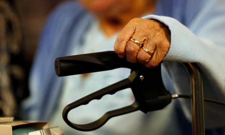 An elderly woman with her walker.