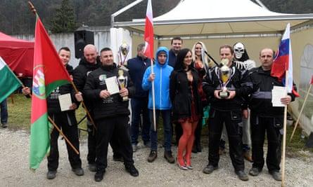 Gravedigging championship winners pose for family photo