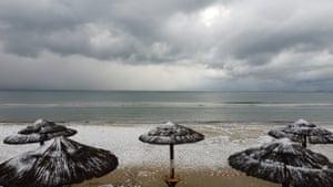 Snow covers the beach in Artemida.