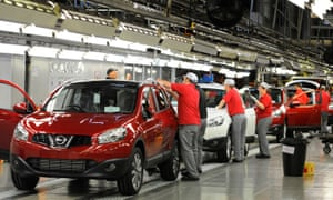 Workers on the production line at Nissan's car plant in Sunderland.