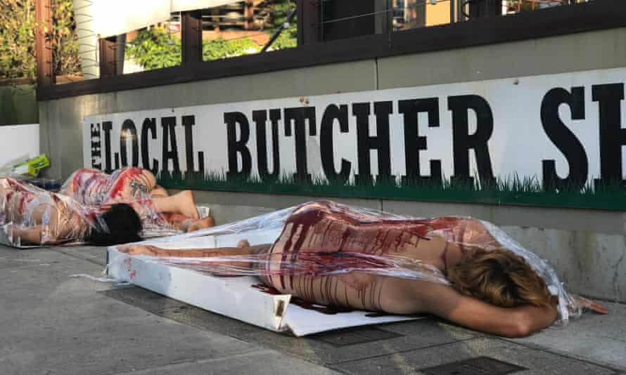 Activists from Direct Action Everywhere stage a protest outside The Local Butcher Shop in Berkeley, California.