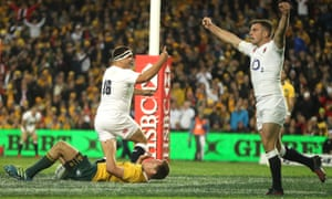 Jamie George, left, celebrates with team-mate George Ford after scoring England's fourth try.