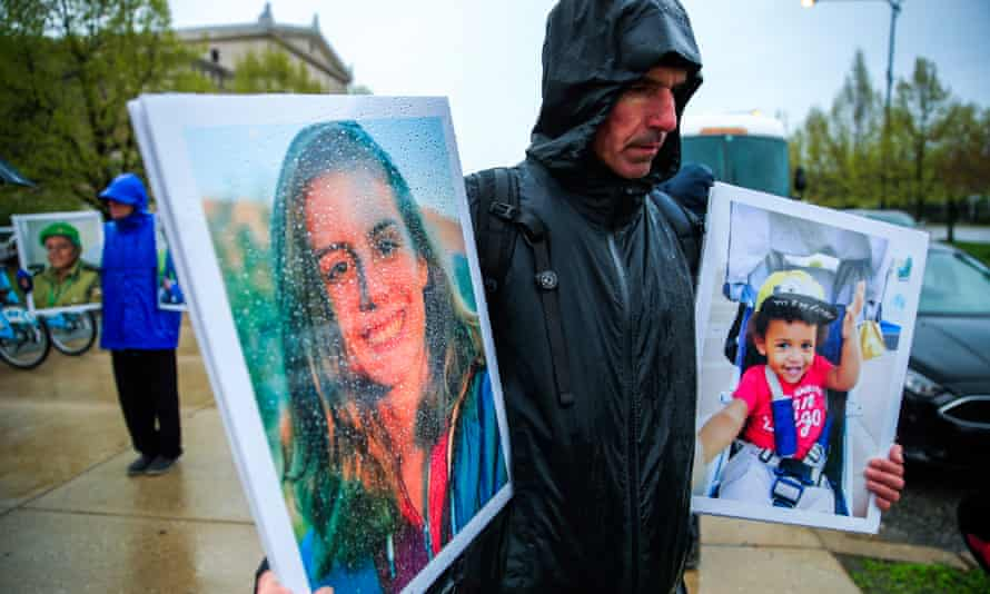 Protesters gather outside the Field Museum holding photographs of people who died in the Ethiopian Airlines and Lion Air crashes.