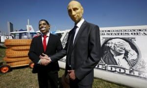 Men dressed as Obama and Putin