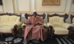 Chérif Haidara sits in his palatial reception room on the fourth floor of his home in Bamako.
