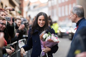 Markle carries a bouquet from a wellwisher