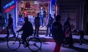 Pedestrians walk at the evening street in Tedmor city in Palmira, Syria