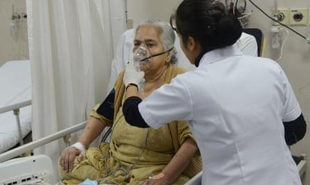 An Indian medic treats a patient at a Delhi hospital during the recent smog crisis.
