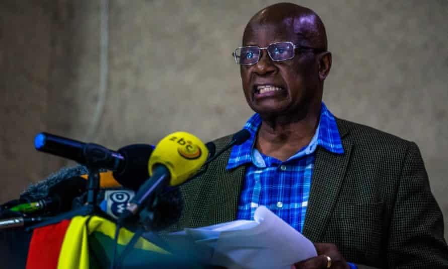 Patrick Chinamasa announces Mugabe's dismissal during the meeting.