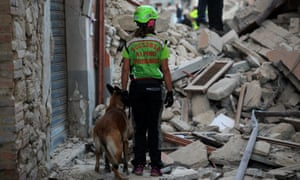 Rescuers search for victims among the rubble of a house after a strong earthquake hit Amatrice.