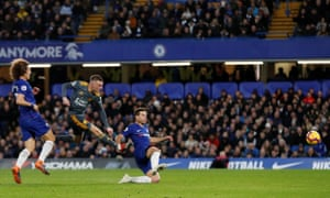 Leicester's Jamie Vardy scores their first goal against Chelsea.