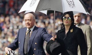 Michael Jackson with Mohamed Al Fayed on a lap of honour at Craven Cottage in April 1999.