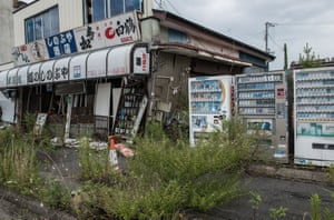 A street in the Fukushima exclusion zone which has been taken over by nature.