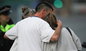 A man embraces a woman and teenager as he collects them from a hotel where they were given refuge after the Manchester Arena attack.