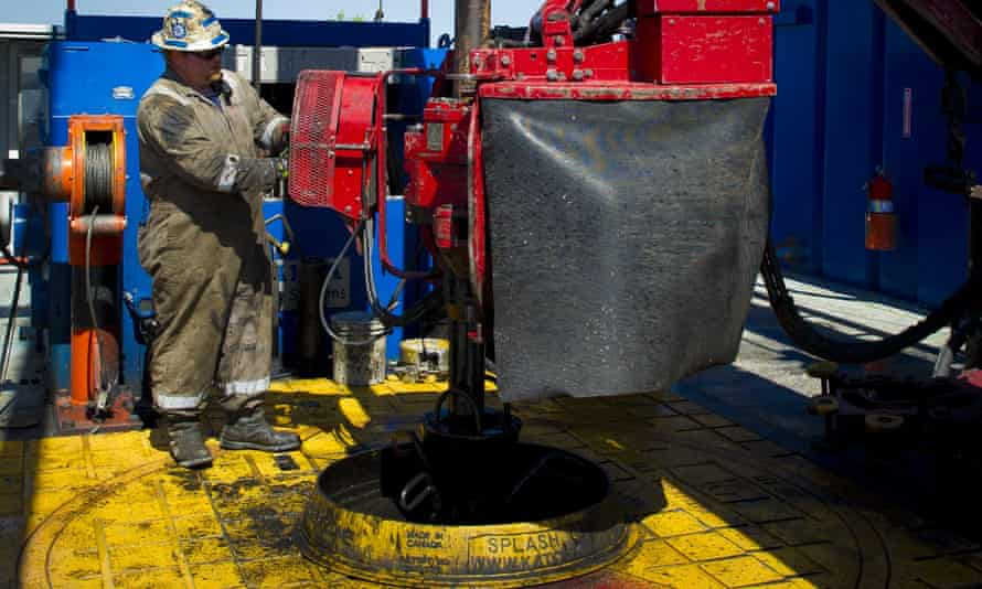 A contract worker drills at a Crig exploring the Marcellus Shale outside the town of Waynesburg, Pennsylvania.