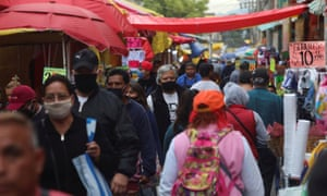 People walk outside a market known as La Merced as the coronavirus outbreak continues, in Mexico City, Mexico 25 June 2020.