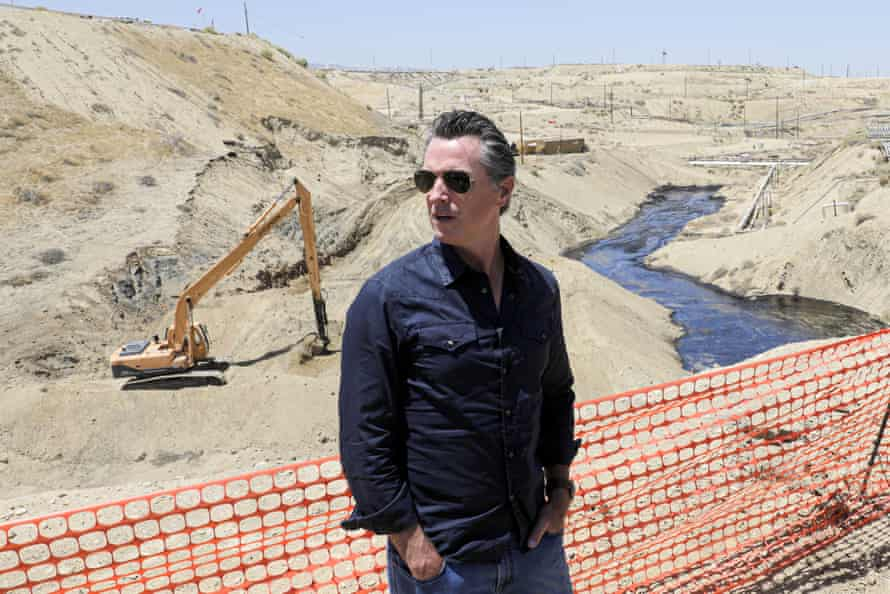Gavin Newsom tours the Chevron oil field west of Bakersfield. Some are calling for the state to take a more interventionist approach to new development.