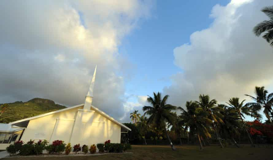 A church surrounded by palm trees