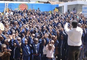 Principal Daniel Ochieng with pupils at Magoso: 'We have become a role model to schools in Kenya.'