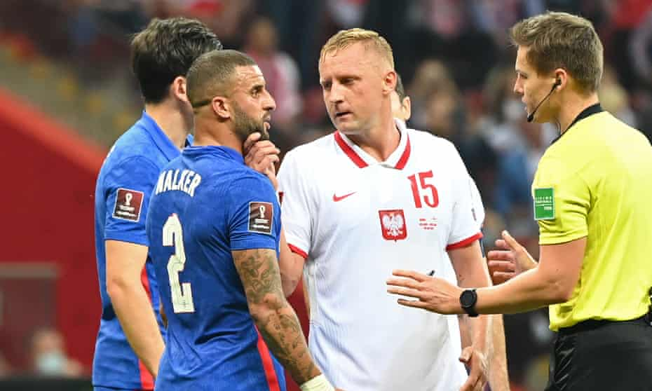 Kamil Glik clashes with Kyle Walker during England's 1-1 draw in Poland on Wednesday.