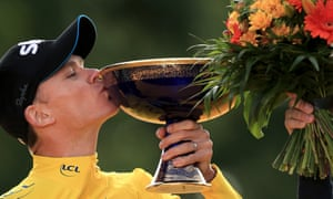 Froome kisses the trophy after winning the 2015 Tour de France.