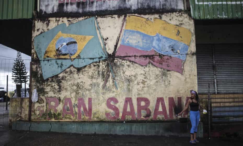A Venezuelan woman is seen in a street in the border city of Pacaraima, Brazil.