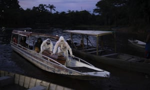 Funeral workers transport by boat the coffin containing the body of a suspected Covid-19 victim that died in a river-side community near Manaus, Brazil.