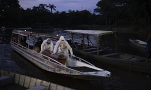 Funeral workers transport by boat the coffin containing the body of a suspected COVID-19 victim who died in a river-side community near Manaus, Brazil.