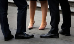 Legs belonging to woman at work, and men in same workplace