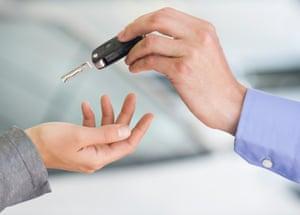 Salesman handing car keys over
